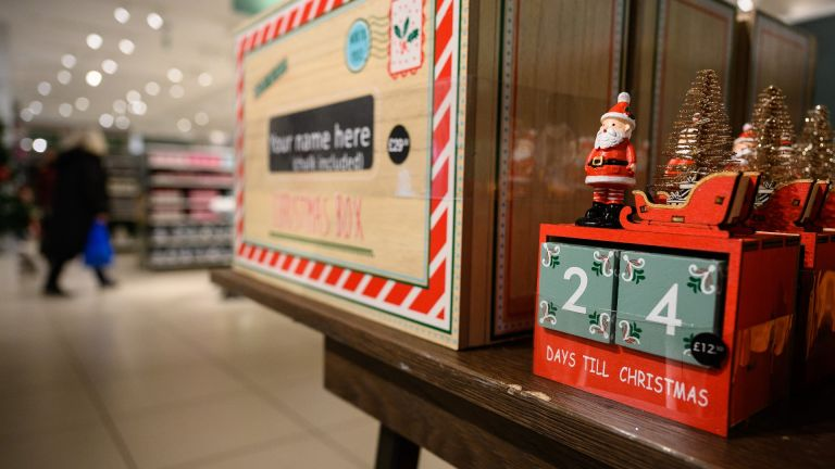 A customer browses some of the festive items in the Christmas gift and decoration section in the branch of retailer Marks and Spencer at Westfield White City
