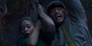 Emily Blunt and Dwayne Johnson in Jungle Cruise swinging around