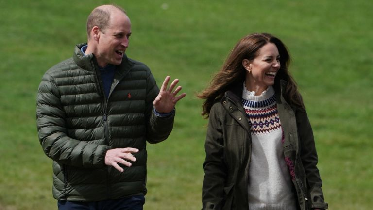 Britain's Prince William, Duke of Cambridge, and Britain's Catherine, Duchess of Cambridge, react during a visit to Manor Farm in Little Stainton, near Durham, north east England on April 27, 2021.