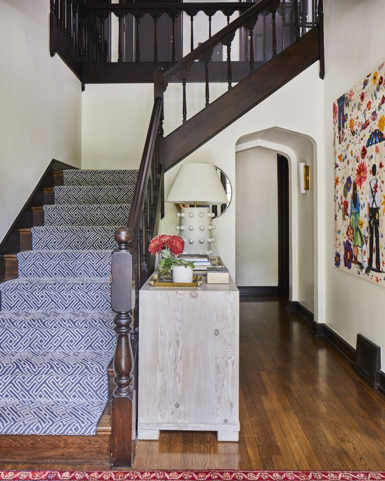 Traditional hallway with patterned blue runner