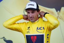 Fabian Cancellara puts on the yellow jersey following stage 2.