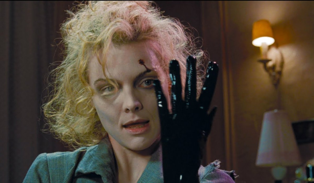 Batman Returns Michelle Pfeiffer tries her glove on for size