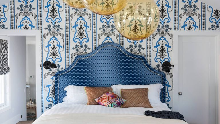Blue and white bedroom with wallpaper