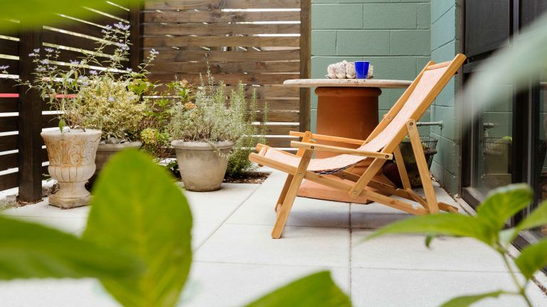 best patio cleaner: patio with deckchair and plants