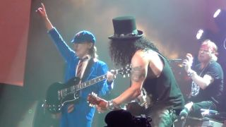 Angus Young with Guns N' Roses at last year's Coachella festival