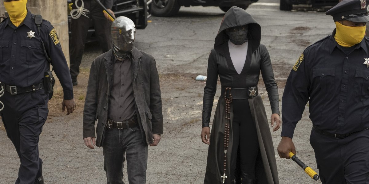 Tim Blake Nelson and Regina King in Watchmen