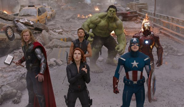 The Avengers standing in formation, looking up at the threat in the sky