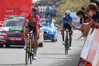 Primož Roglič (Jumbo-Visma) crosses the finish of stage 9 ahead of Enric Mas (Movistar)