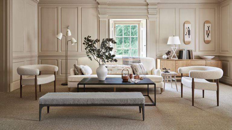 White sofa living room ideas with taupe walls and white curved armchairs