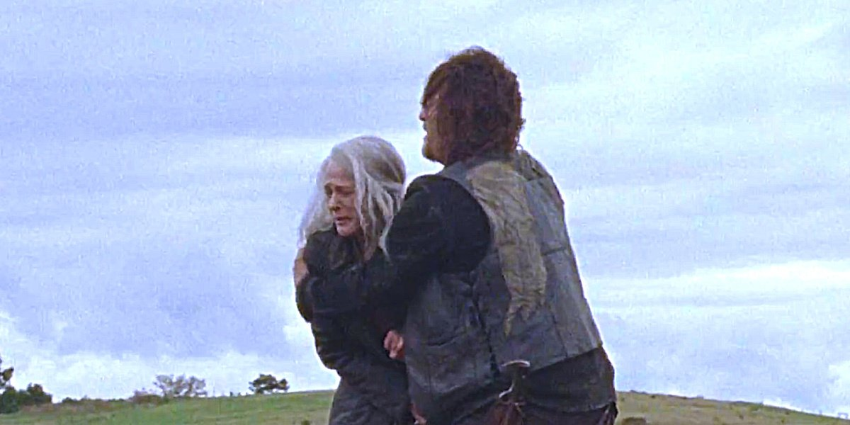 Daryl tries to shield Carol in The Walking Dead.