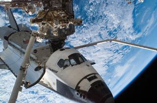Space Shuttle Endeavour sits docked to the Destiny laboratory of the International Space Station during the STS-118 mission's third planned session of extravehicular activity (EVA).