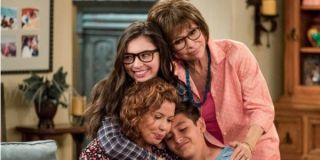 One Day At A Time the Alvarez family in a heap of hugs in the living room