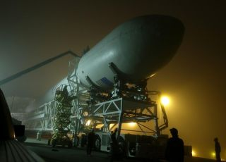 SpaceX's first upgraded Falcon 9 rocket, a Falcon 9 v1.1, rolls out to its launch pad at Vandenberg Air Force Base in California for a September 2013 launch debut.