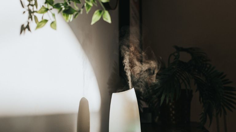 A white Oil Diffuser / Humidifier in a Domestic Setting - stock photo