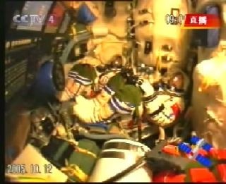 Shenzhou 6 Astronauts Rack up a Day of Firsts for China