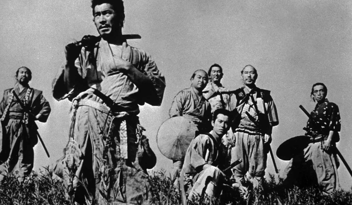 Seven Samurai lined up on a hill
