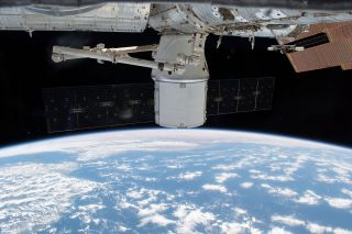 NASA and SpaceX have postponed the return to Earth of the CRS-14 Dragon cargo ship (seen here at the International Space Station) to Saturday, May 5, 2018, due to rough seas at its splashdown zone.