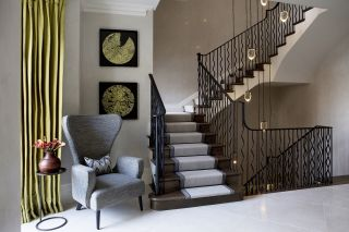 a beautiful staircase lighting idea with a pendant light dropping between storeys