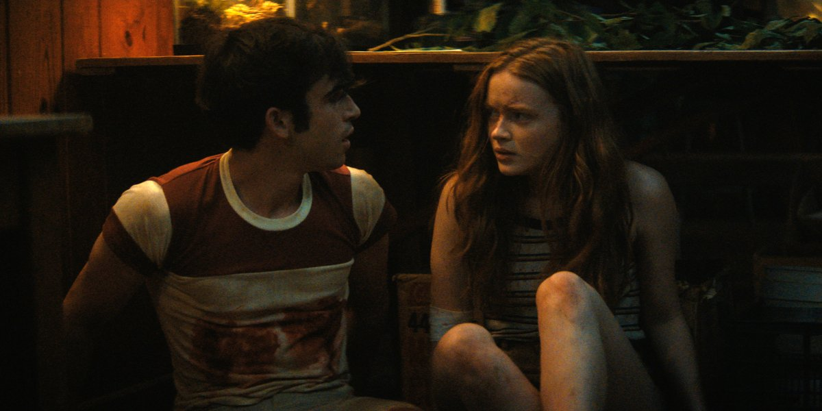 Ted Sutherland and Sadie Sink take cover in Fear Street: Part 2  - 1978.