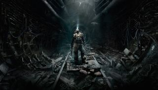 Metro Last Light promotional art. A man s tands in a grey, washed out subway tunnel. He is wearing a gas mask.