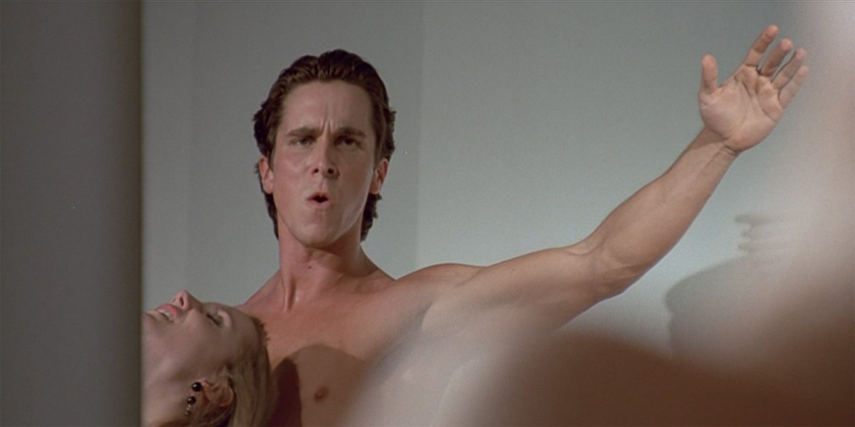 American Psycho Christian Bale as Patrick Bateman looking at himself in the mirror