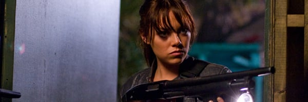 Emma Stone holding a shotgun in Zombieland