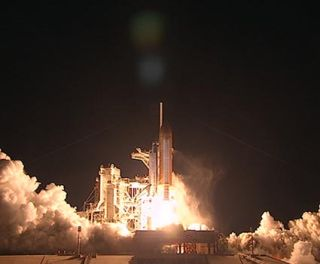 Space Shuttle Discovery lift-off for STS-131 space mission