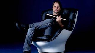 Drummer Dave Lombardo holding drumsticks