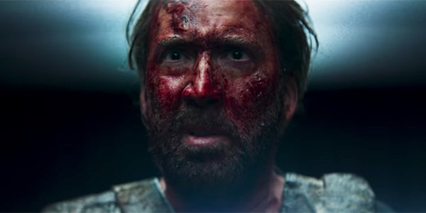 Nicolas Cage, with a face covered in blood in Mandy