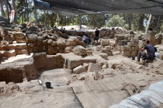 Archaeologists among the stones at Horbat Ha-Gardi, which may hold the ruins of the Tomb of the Maccabees.