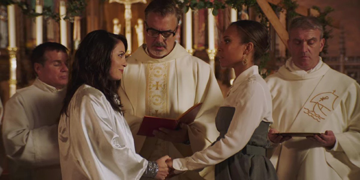 Chris Noth, Adriana DeMeo, and Nia Fairweather in A New York Christmas Wedding