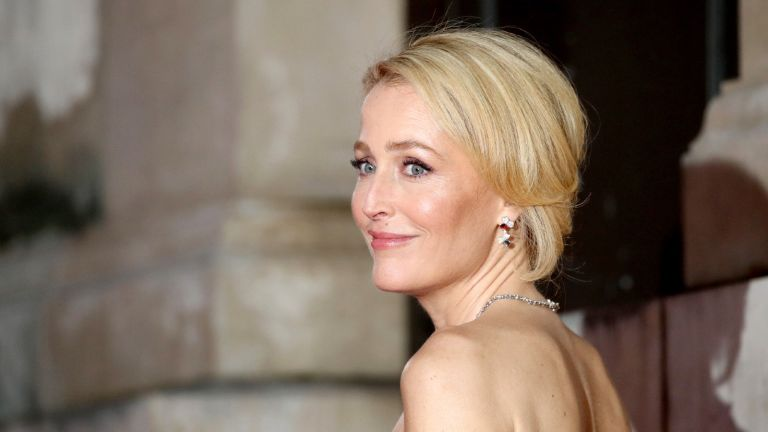 gillian anderson with hair up smiling