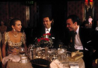 Kate Hardie, Gary and Martin Kemp chat during dinner at a restaurent