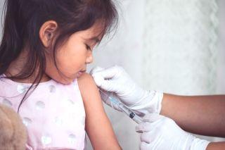 A child getting a flu shot.