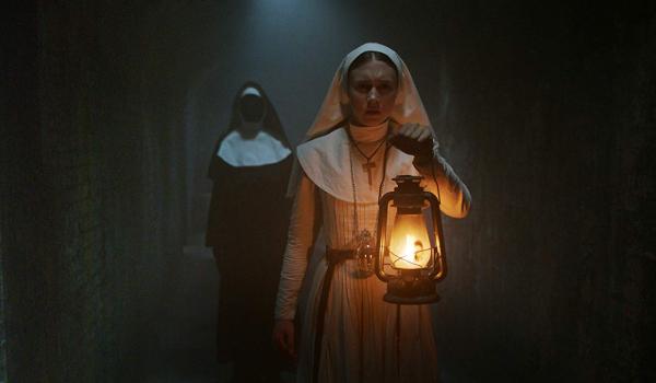 The Nun Taissa Farmiga wandering through the tunnels in front of Valak