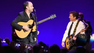 A picture of Dave Matthews and Michael J Fox on stage in New York