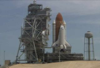 Space Shuttle Atlantis Returns to Launch Pad After Repairs