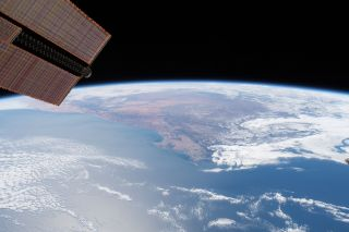 A photograph of the International Space Station flying over Cape Town, South Africa.