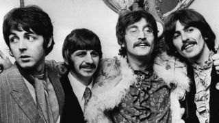 The Beatles Standing With Their Arms Around Each Others Shoulders In 1967