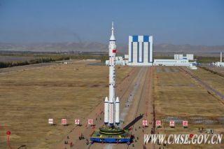 China's Long March 2F rocket, carrying the Shenzhou 8 spacecraft, rolls to the launch pad in preparation for its November 2011 launch.