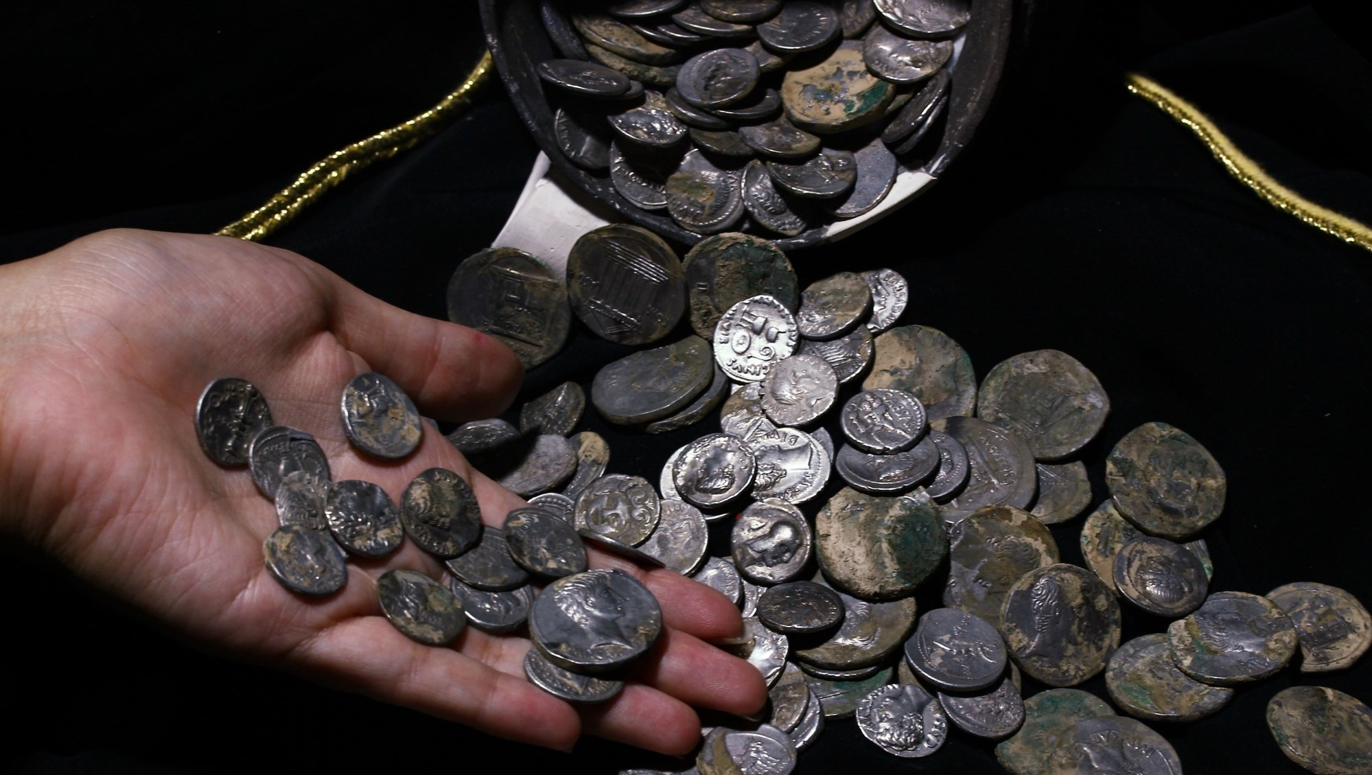 The coins are about 2,100 years old.