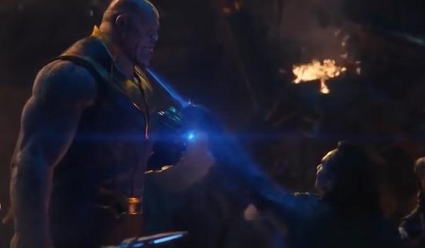 Loki stabs with his left hand