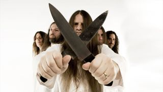 A photograph of Cannibal Corpse holding knives