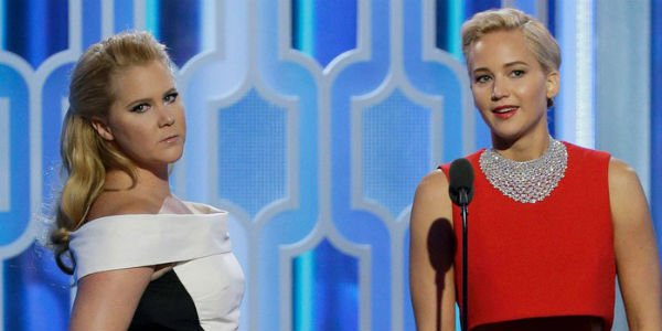 Amy Schumer and Jennifer Lawrence presenting an award