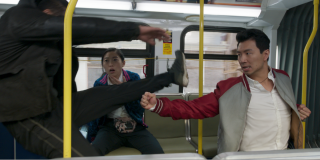 Shang-Chi fighting for his life on the bus in Shang-Chi and the Legend of the Ten Rings