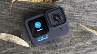 The GoPro Hero 10 Black action camera sitting on a wooden bench