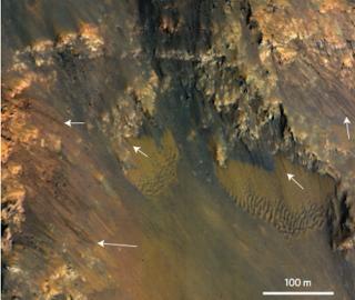 Dark Streaks on Slopes of Mars