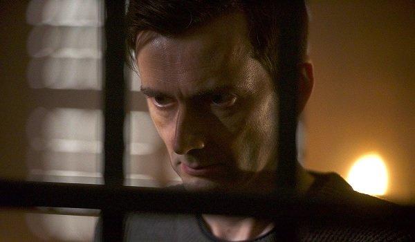 Bad Samaritan David Tennant looking evil through the bars