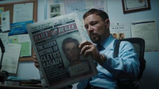 Stephen Graham reading a newspaper in Venom: Let There Be Carnage