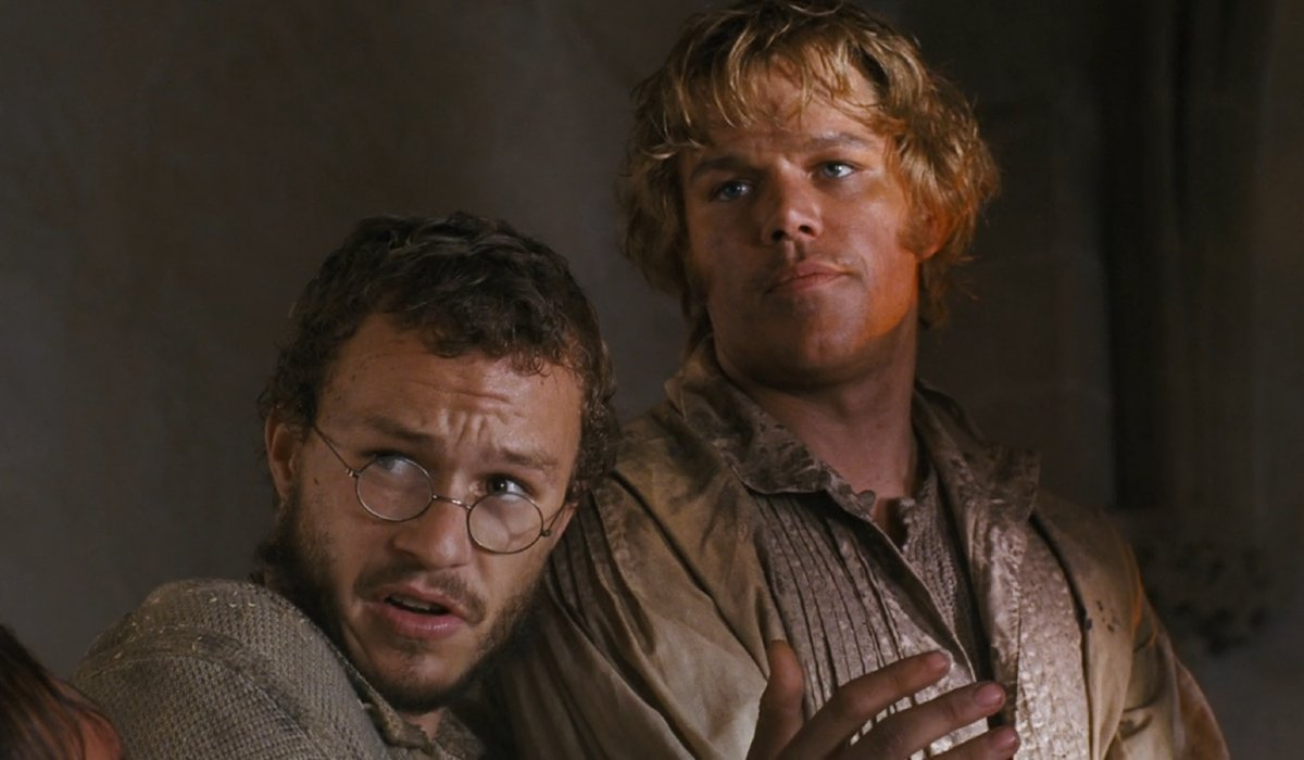 The Brothers Grimm Heath Ledger tells a story while Matt Damon smirks